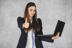 Thumbs up for new technological solutions, businesswoman. Thumbs up for new technological solutions Stock Photos