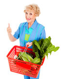 Thumbs Up For Nutrition. Beautiful senior lady shopping for fresh produce, giving a thumbs up for nutrition.  Isolated on white Royalty Free Stock Photo