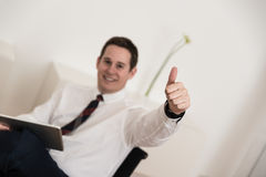 Thumbs up at the office on chair Royalty Free Stock Photos