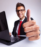 Thumbs up at office desk Royalty Free Stock Photos
