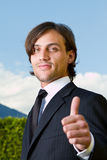 Thumbs up over blue skies Royalty Free Stock Photos