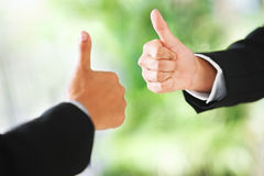 Thumbs up over green background Royalty Free Stock Images