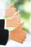 Thumbs up over green background stock photos