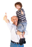 Thumbs-up pair of grandfather and grandson Stock Photo