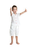 Thumbs up! Portrait of happy joyful beautiful little boy Royalty Free Stock Photos