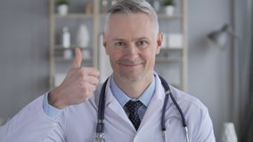 Thumbs Up by Positive Doctor with Grey Hairs stock video footage