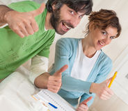 Thumbs-Up Power Couple. A young good looking couple giving a thumbs up Royalty Free Stock Images