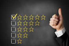 Thumbs up rating stars Stock Photos