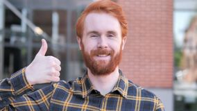 Thumbs Up by Redhead Beard Young Man, Outdoor. 4k high quality, 4k high quality stock video