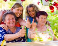 Liking of retirement. Thumbs up for retirement from happy granddaughters and their granny Royalty Free Stock Image