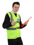 Thumbs up security guard. A thumbs up security guard, isolated on white stock photo