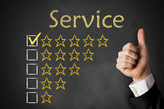 Thumbs up service rating stars chalkboard Royalty Free Stock Images