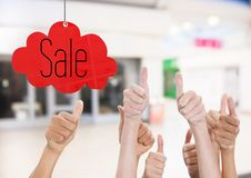 Thumbs up in the shopping center, sale royalty free stock photography