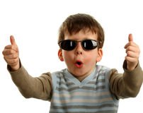 Thumbs up shown by a happy young boy on glasses. Isolated on white Royalty Free Stock Photo