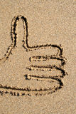 A thumbs-up sign. A thumbs-up sign drawn on the beach Stock Image