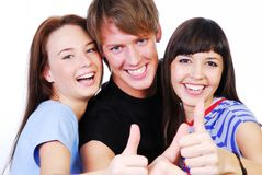 Thumbs-up sign. Portrait of a three young teenagers laughing and giving the thumbs-up sign Royalty Free Stock Photos