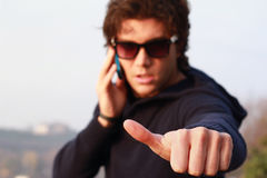 Thumbs-up sign from cool guy Stock Photo
