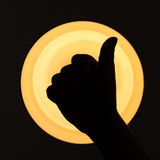 Thumbs up sign Stock Photo