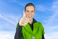 Thumbs up sign over blue sky. Royalty Free Stock Photography