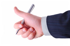 Thumbs up and silver pen. Businessman shows thumb up and holds silver pen Stock Photography