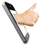 Thumbs up in smartphone Stock Photos