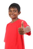 Thumbs up and smile from young teenager boy studio Stock Photography