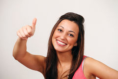 Thumbs up - smiling ethnic female Royalty Free Stock Photography