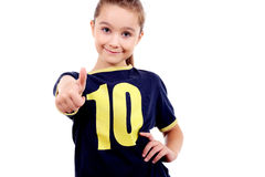 Thumbs up! Smiling girl in sport's shirt Stock Photo