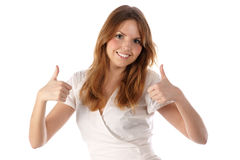 Thumbs up. Smiling young female Royalty Free Stock Photos