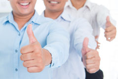 Thumbs up Southeast Asian business man. Thumbs up Southeast Asian business group standing in office Royalty Free Stock Image