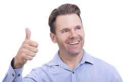 Thumbs up for success. Handsome Caucasian man smiles and holds hand with one thumb up to celebrate success and optimism on white background Royalty Free Stock Image