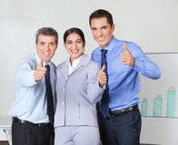 Thumbs up from successful business Royalty Free Stock Photography
