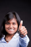 Thumbs up by a successful indian girl Royalty Free Stock Image
