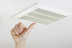 Thumbs Up after successfully cleaning and installing fan vent royalty free stock image