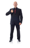 Thumbs up suit. Smiling man in suit gesturing thumbs up sign  on white Royalty Free Stock Photos