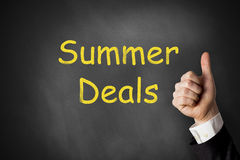 Thumbs up summer deals black chalkboard Stock Image