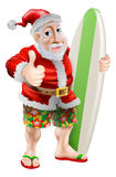 Thumbs up surfing Santa Claus Royalty Free Stock Photos