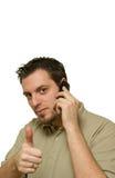 Thumbs-up am Telefon Stockfoto