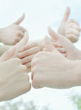 Thumbs up. Three people showing thumbs up Royalty Free Stock Photo