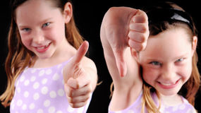 Thumbs Up and Thumbs Down Stock Photos