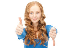 Thumbs up and thumbs down Royalty Free Stock Photography