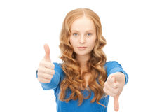 Thumbs up and thumbs down Stock Photography