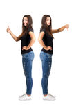 Thumbs up and thumbs down contrast. Full body length isolated over white stock photos