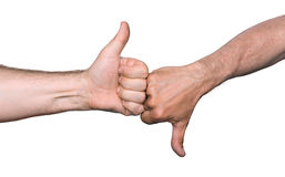 Thumbs up and thumbs down hand signs. Clash of the thumbs up and thumbs down hand signs  on white Royalty Free Stock Images