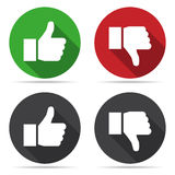 Thumbs up and thumbs down icons with shadow in a flat design Stock Photography