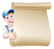 Thumbs up tradesman scroll. Cartoon mechanic, plumber, handyman, decorator or gardener leaning around a scroll and giving a thumbs up Royalty Free Stock Photo