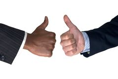Thumbs up for two. Black and white thumbs up in front of white background Royalty Free Stock Photo