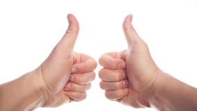 Thumbs up. Two hands appearing on white background and showing thumbs up, disappearing at the end stock video footage