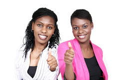 Thumbs up - two women Stock Image