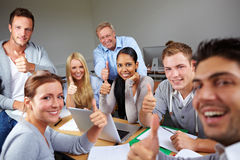 Thumbs up in university Royalty Free Stock Photos